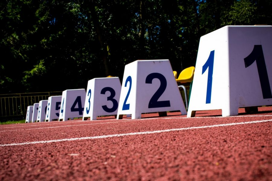 Starting lane markers representing litigation race in IP market